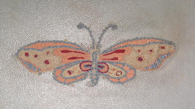 Embroidery of two butterflies on silk voile
