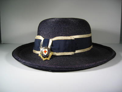 Navy wide brimmed straw hat. With navy/white ribband and Officer's hat badge