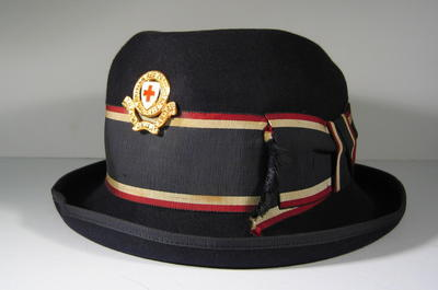 British Red Cross navy felt hat with red/white/blue riband and gilt hat badge.