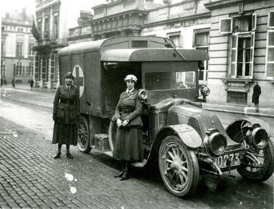 Two British female ambulance drivers with their vehicle