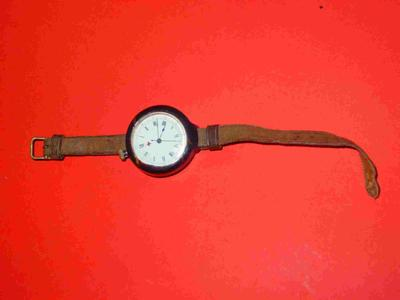 wristwatch with red cross emblem on dial