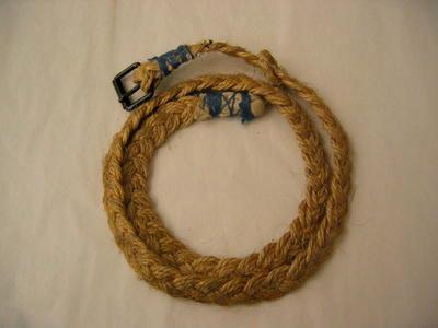 Belt made from plaited string with black metal buckle.