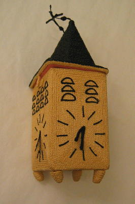 Box made from plaited string in the form of a clock tower