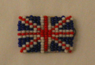 Brooch made from coloured beads in form of Union Jack.