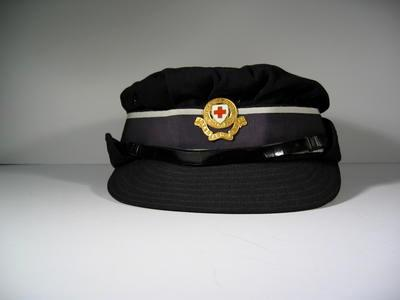 British Red Cross gabardine cap with Member's Hat badge, riband and leather strap. Named: M G Carter, Size: 6 7/8
