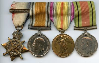 Presentation case of medals containing group awarded to F A Jones