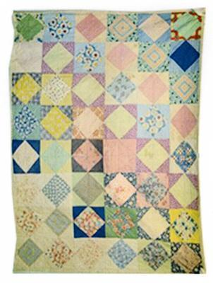 patchwork quilt of floral pattern with multi-coloured diamonds on white squares; Textiles/quilt; 1158/1