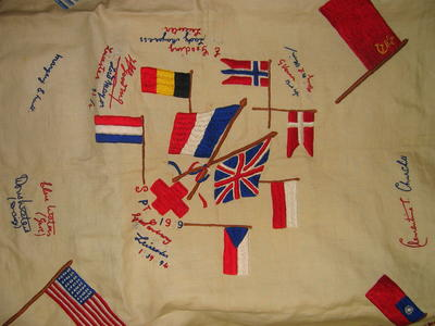 tablecloth emboidered with flags and signatures