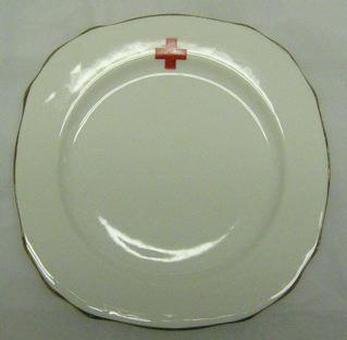 plate with emblem and gold rim