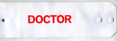 White PVC armband with red fluorescent lettering: Doctor