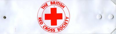 White PVC armband worn by Members including First Aiders with red lettering: The British Red Cross Society