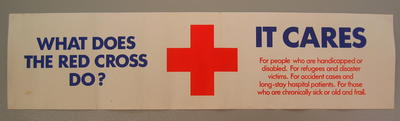 Small banner/poster: 'What Does The Red Cross Do? It Cares. For people who are handicapped or disabled. For refugees and disaster victims. For accident cases and long-stay hospital patients. For those who are chronically sick or old and frail.'