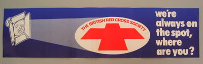 Small banner/poster: 'The British Red Cross Society. We're always on the spot, where are you?'
