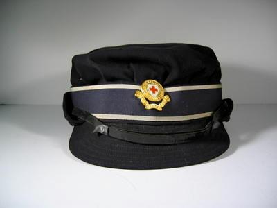 British Red Cross member's gabardine cap with gilt hat badge