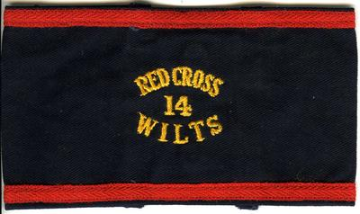Navy blue brassards with red braid trim embroidered 'Red Cross Wilts 14'