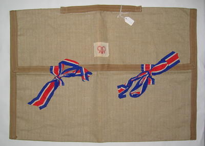 Presentation cloth bag with ties in red, white and blue ribbon. Bears tag 'A Gift from Queen Alexandra' and the Joint Committee emblem.
