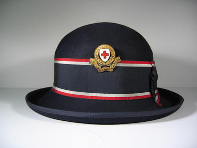 navy bowler hat with red/white/blue riband and gilt hat badge