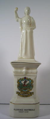 Porcelain figure of Florence Nightingale standing on a plinth