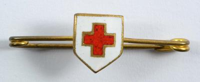 Brooch badge with Red Cross emblem in white shield