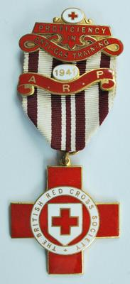 Proficiency in Anti-Gas Training badge with 1941 A.R.P. bar.