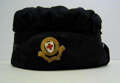 woman ambulance driver's storm cap, navy blue cloth with stitched cloth peak and gilt hat badge