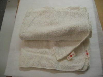 4 nappies with sewn on labels: Gift of the Canadian Junior Red Cross