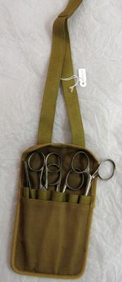 Nurse's small canvas chatelaine containing tweezers, scissors and forceps.