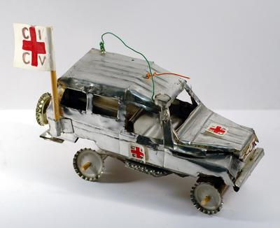 Model Red Cross large land cruiser made from cooking oil tins by children in Angola