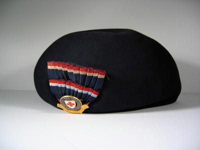 Navy blue felt hat with cockade and officers hat badge