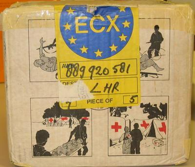 Cardboard box containing food items with illustrations of the work of the Red Cross.