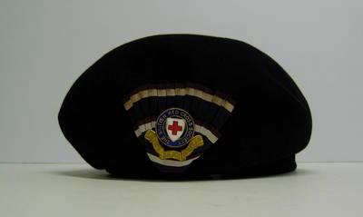 Navy blue felt hat with cockade and officer's hat badge with 'B.R.C.S' label