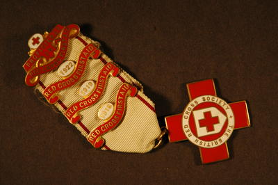Proficiency badge in First Aid, 15 June 1917. With three additional bars 1918, 1919 and 1922