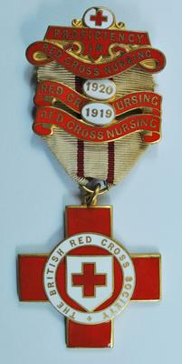 Proficiency badge in Home Nursing, [1918]. With two additional bars 1919 and 1920