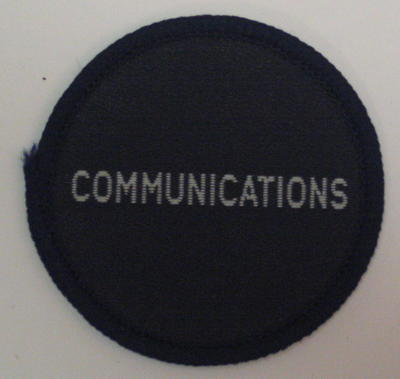 Circular cloth badge: Communications