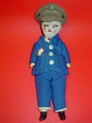 doll dressed in convalescent blues