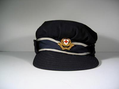 British Red Cross navy blue gabardine cap with riband and hat badge