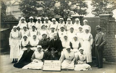 Group of medical staff and VADs outside the Michie Hospital, Queen's Gate in London
