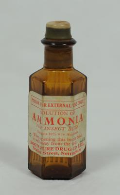 Small glass bottle containing Solution of Ammonia, manufactured by Boots.