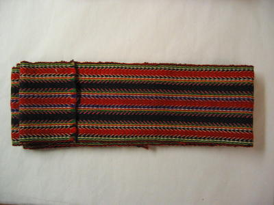 long woven braid in red, yellow, green, white, black and pink