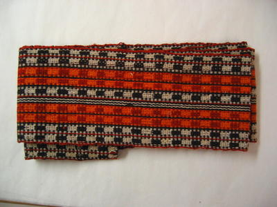 long woven braid in orange, red, black and white