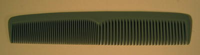 Grey plastic comb, made by Boots.