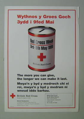 Large poster with an image of a collecting tin: 'The more you can give, the longer we can make it last. For more information, please contact British Red Cross North Wales Branch.'