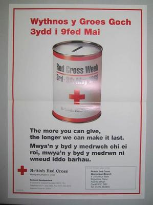 Large poster with an image of a collecting tin: 'The more you can give, the longer we can make it last. For more information, please contact British Red Cross Glamorgan Branch.'