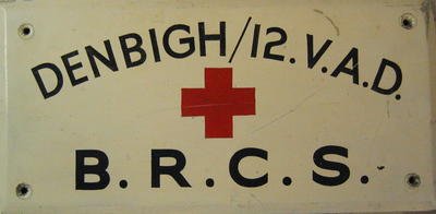 Wooden sign: 'Denbigh/12 VAD BRCS'