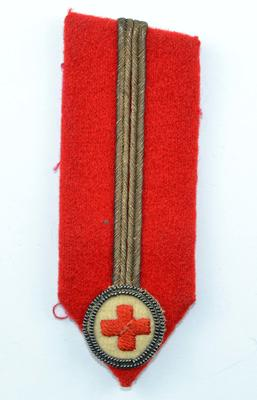Gorget patch: red with gold line with embroidered emblem. Worn by County President.