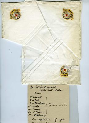 White handkerchief with the 'British Red Cross Society' embroidered in one corner.