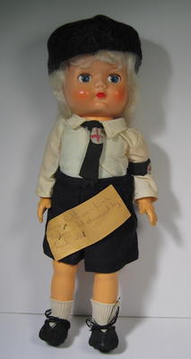 doll dressed as a Junior Red Cross member