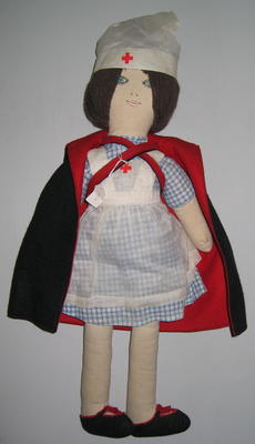 Rag doll in Red Cross nurses uniform with cape
