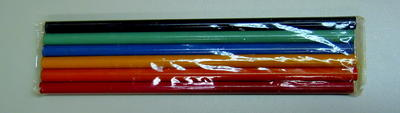 6 coloured pencils in a plastic wrapper: red, orange, yellow, blue, green and black.