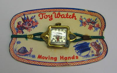 Small plastic toy watch, mounted on card. Made in West Germany.